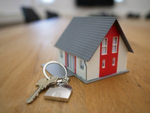 Picture of a miniature house with keys to illustrate actions of property solicitors Cork